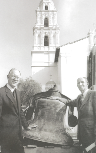 image of Joe Shally and Brother Mel with the St. Mary's bell